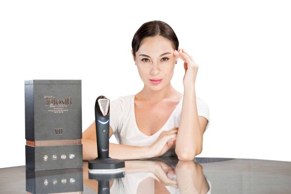 woman modeling next to TELOSIN PRODUCT