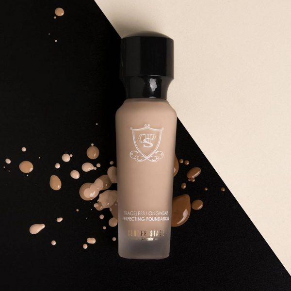 premier Traceless Longwear Perfecting Foundation on black and beige surface