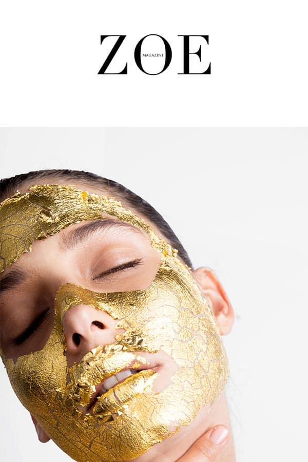 zoemagazine logo and a model with Mimi Luzon's 24 K Pure Gold Leaf Mask.
