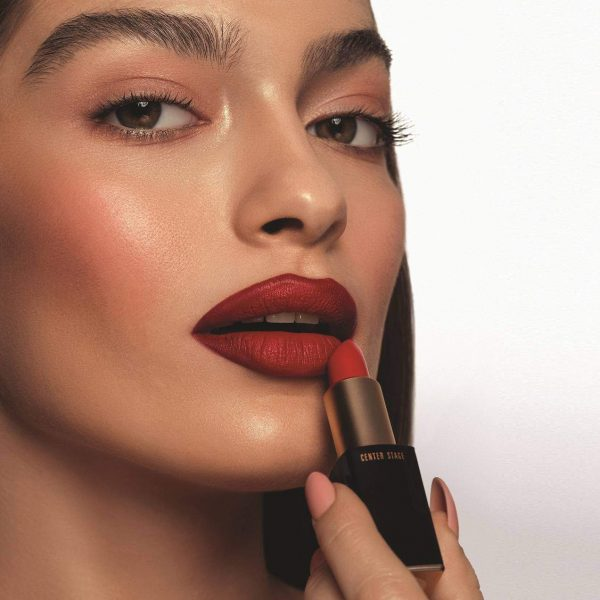 woman using premier dead sea red lipstick