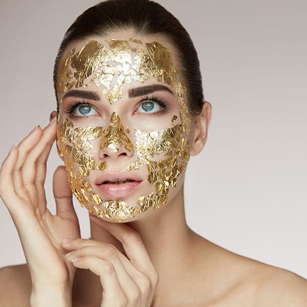 A model with gold mask